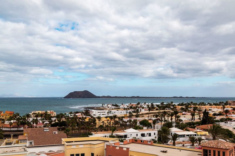 Isla de Lobos at Corralejo Palm Trees Ocean Isla De Lobos  Island Building Exterior Architecture Sky Cloud - Sky Built Structure Horizon Over Water Sea House High Angle View Residential Building No People Town Day Roof Cityscape Water Outdoors City Nature Scenics Summer Exploratorium
