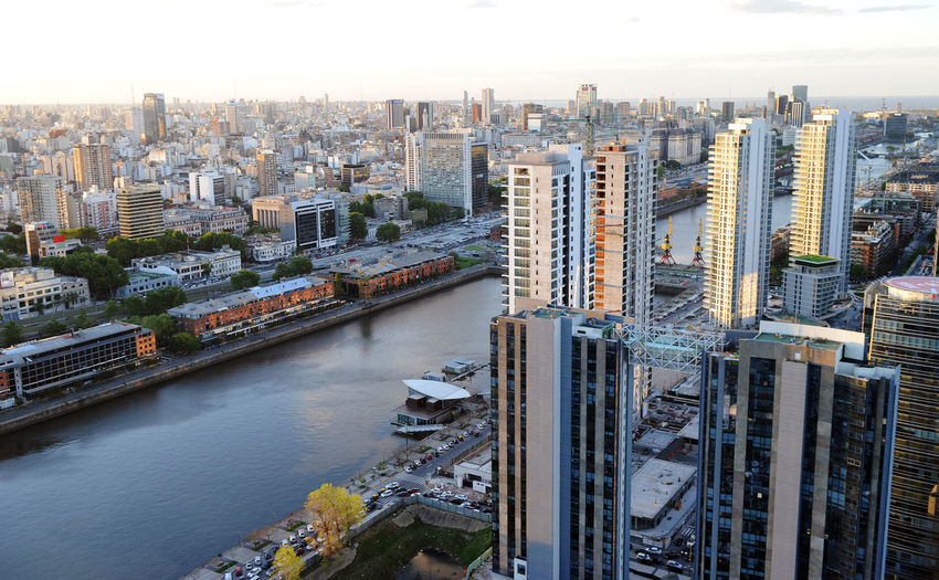 High angle view of river amidst buildings against sky