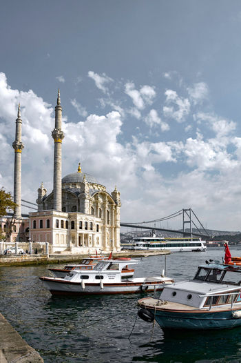 Boats Sailing In Harbor By Ortaköy Mosque