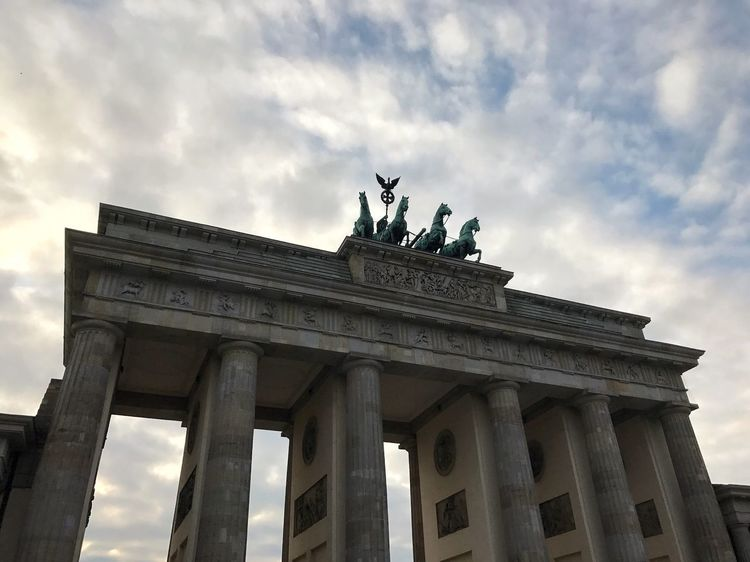 Brandenburger Tor, Berlin, Germany Cloud - Sky City Gate Statue Low Angle View Sky Built Structure Sculpture Architectural Column History Travel Destinations Building Exterior Art And Craft Travel Tourism Outdoors Human Representation Day Monument No People