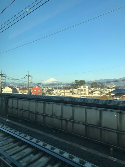 Mt. Fuji is a majestic sight. Built Structure Architecture Transportation Cable Connection Building Exterior Sky No People Bridge - Man Made Structure Power Line  Outdoors Rail Transportation Railroad Track Day Railing City Electricity Pylon Mt Fuji EyeEm Bullet Train Nature Photography