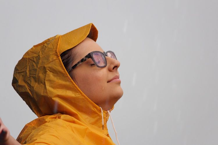 Close-up of woman wearing eyeglasses during rainy season