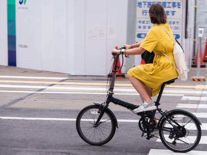 Side view of woman cycling on bicycle