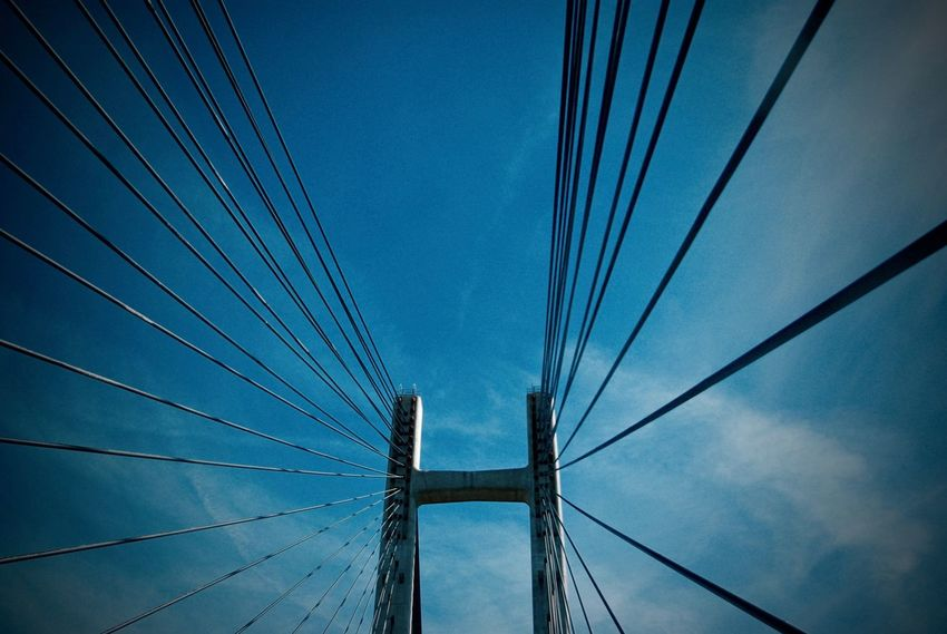 Architecture Blue Bridge - Man Made Structure Built Structure Cable Connection Day Electricity Pylon Engineering Low Angle View No People Outdoors Sky Suspension Bridge