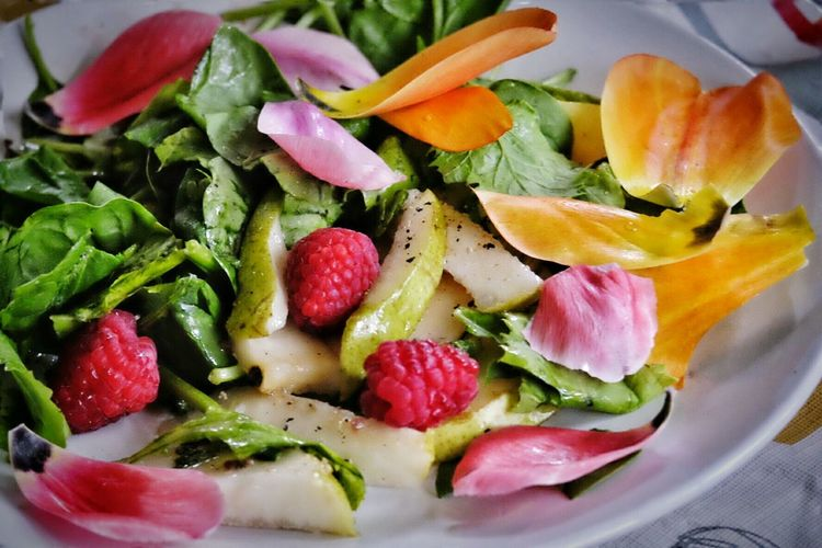 Fruit And Vegetable Leaf Salad With Pink And Yellow Flower Petals