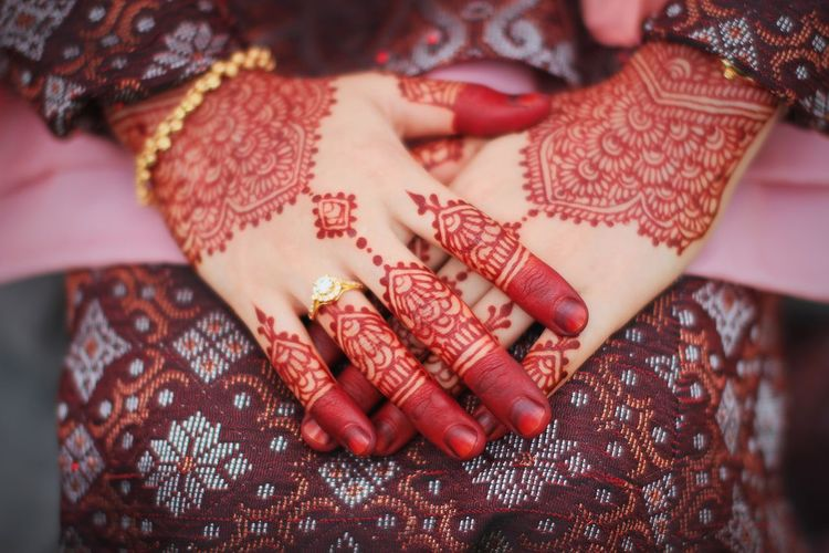 Close-Up Of Woman With Henna Tattoo