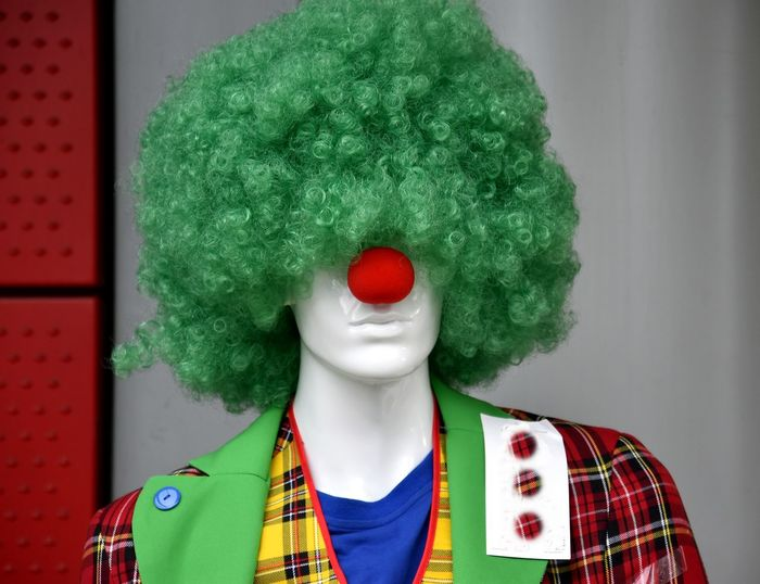 Close-up of mannequin wearing clown costume