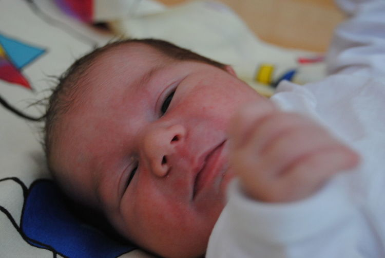 Close-up of child lying in crib
