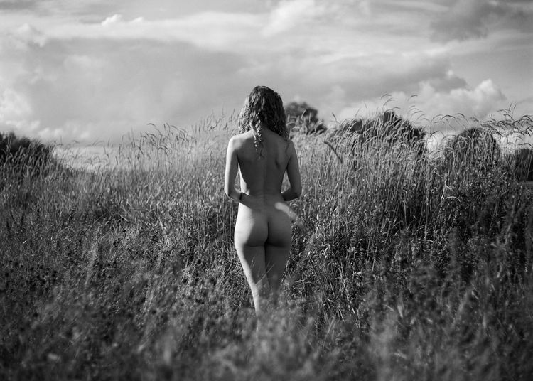 One Person Land Cloud - Sky Real People Lifestyles Field Rear View Grass Leisure Activity Nature Plant Day Young Adult Young Women Women Sky Swimwear Hairstyle Outdoors Beautiful Woman Analogue Photography Analog Medium Format
