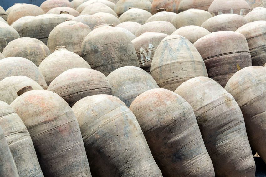 Amphoras used in the production of pisco seen in Ica, Peru Agriculture Amphora Amphoras Architecture Backgrounds Clay Colorful Day Distillery Farming Field Historic Ica Jar Landscape Nature Order Outdoors Peru Pisco Production Seen Stone Travel Wine