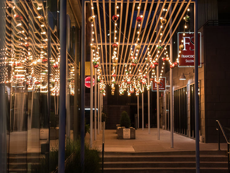 AUSTIN, TEXAS - DECEMBER 31, 2017: Holiday decorations light up the small walk way next to Francisco's Salon located on Congress Ave. Holiday Lights Architecture Arts Culture And Entertainment Austin, Texas Building Building Exterior Built Structure City Decoration Decoration Lights Electricity  Footpath Glowing Illuminated Light Lighting Equipment Night No People Outdoors Restaurant Sign Text Transportation