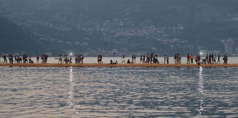 Floating On Water Floating Piers Iseo Lake Italy Brescia 2016 Christo Sulzano Crowd Water Large Group Of People Group Of People Real People Waterfront Lifestyles Sea Nature Leisure Activity Men Women Beach Land Day Trip Vacations Holiday Outdoors Pilgrimage