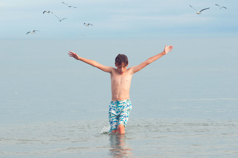 Beach Birds Blue Boy Child Childhood Day Fly Happiness Lake Leisure Activity Nature One Person Outdoors People Sea Sky Summer Summertime Vacations Water