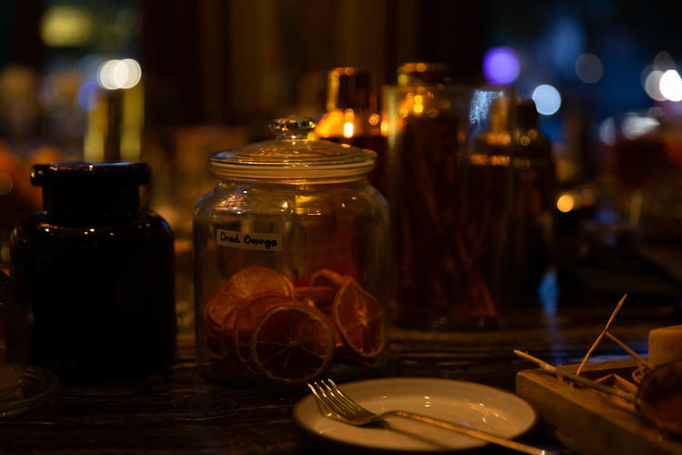 Close-up of glass jar on table in restaurant