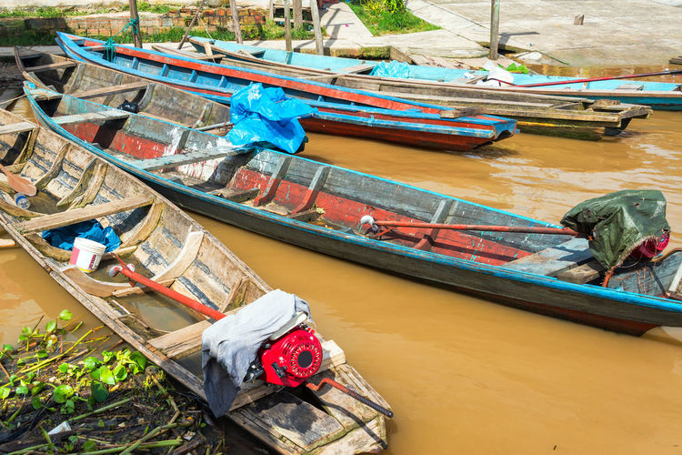 Canoes tied to shore floating on the Amazon River near Iquitos, Peru Amazon Amazon River Amazonas Brown Canoe Day Iquitos  Jungle Latin America Mode Of Transport Moored Muddy Nautical Vessel No People Outdoors Peru Rain Forest Rainforest River South America Transportation Water