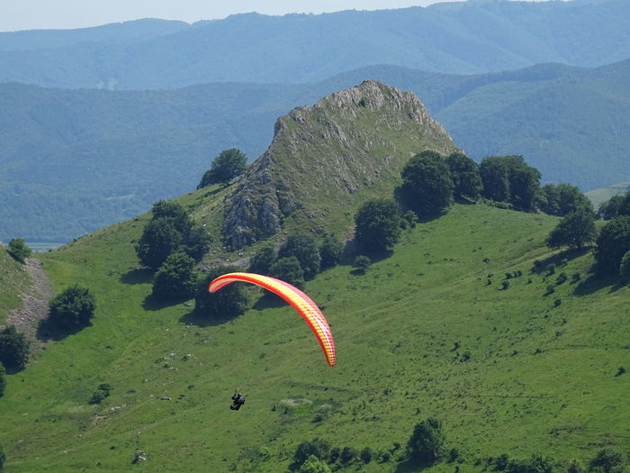 Adventure Beauty In Nature Day Environment Extreme Sports Flying Freedom Green Color Landscape Mid-air Mountain Mountain Range Nature Non-urban Scene Outdoors Parachute Paragliding Plant Scenics - Nature Sport Tranquil Scene Tranquility The Great Outdoors - 2018 EyeEm Awards