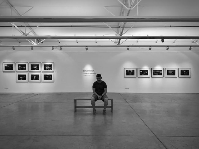Show EyeEmNewHere EyeEm Best Shots Alone Loneliness Blackandwhite Architecture One Person Full Length Real People Men Indoors  Rear View Built Structure Lifestyles Building Transportation Illuminated Rail Transportation Sitting Seat Leisure Activity Waiting Flooring Adult Ceiling