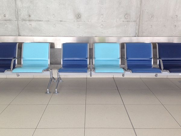 In The Terminal Missing Empty Chair Emptiness Empty Chairs Chairs Blue Grey Wall Airport