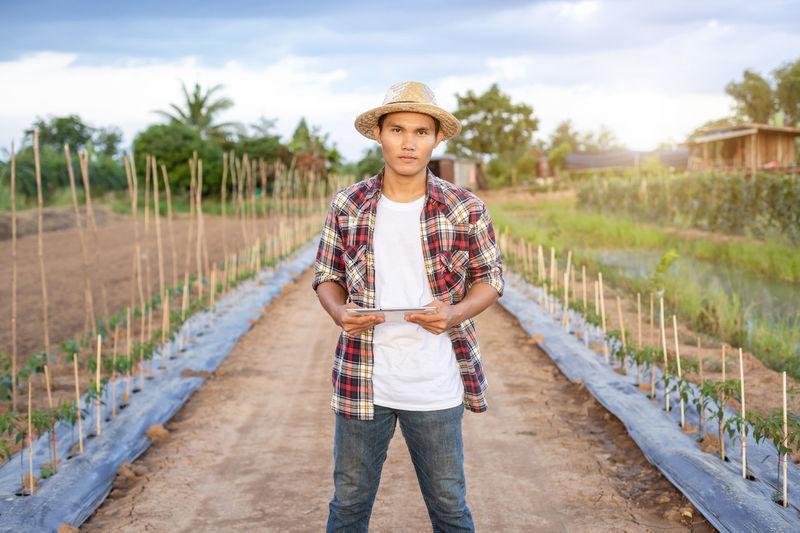 Full length portrait of senior woman standing in farm