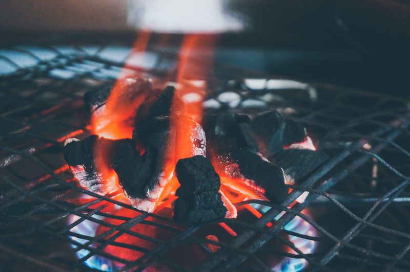 Close-up of burning coal on barbecue grill
