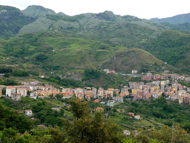 View of the village of Verbicaro and the Pollino mountains Italia South Italy Architecture Beauty In Nature Building Exterior Calabria Cityscape Green Color High Angle View Mountain Mountain Range Nature Outdoors Travel Destination Tree Urban Landscape Urban Skyline Verbicaro