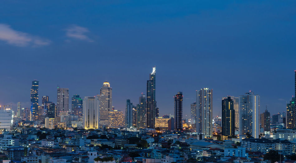 Smart city. Financial district and skyscraper buildings. Bangkok downtown area at night, Thailand. Architecture Bangkok City Cityscape Downtown Financial District  Smart Thailand Architecture Building Building Exterior Buildings Built Structure City Cityscape Connection Financial District  Illuminated Landmark Landscape Metropolis Modern Nature Network No People Office Office Building Exterior Outdoors Residential District Sky Skyscraper Spire  Tall - High Technology Tower Travel Destinations Urban Skyline