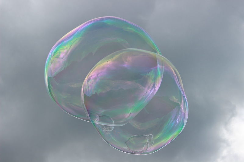 Dreams & Bubbles flying high Beauty In Nature Blowing Bubble Bubble Wand Close-up Day Double Rainbow Fragility Freshness Green Color Mid-air Multi Colored Nature No People Outdoors Rainbow Refraction Sky Soap Sud Spectrum