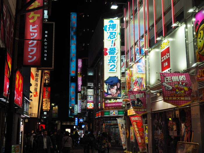 Advertisement Architecture Billboard Building Exterior Built Structure City Communication Illuminated Incidental People Multi Colored Neon Night Outdoors People Real People Shinjuku Store Text Tokyo Tokyo,Japan Travel Destinations