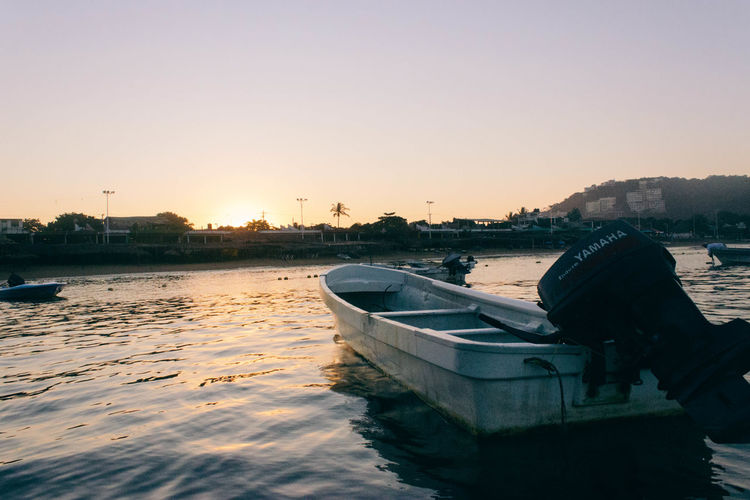 Boats in the Morning. Beauty In Nature Boat Calm Day Lake Men Nature Nautical Vessel Nopeople One Man Only Only Men Orange Outdoors Pedal Boat People Reflection Sky Sun Sunrise Sunset Tranquility Travel Vacation Water