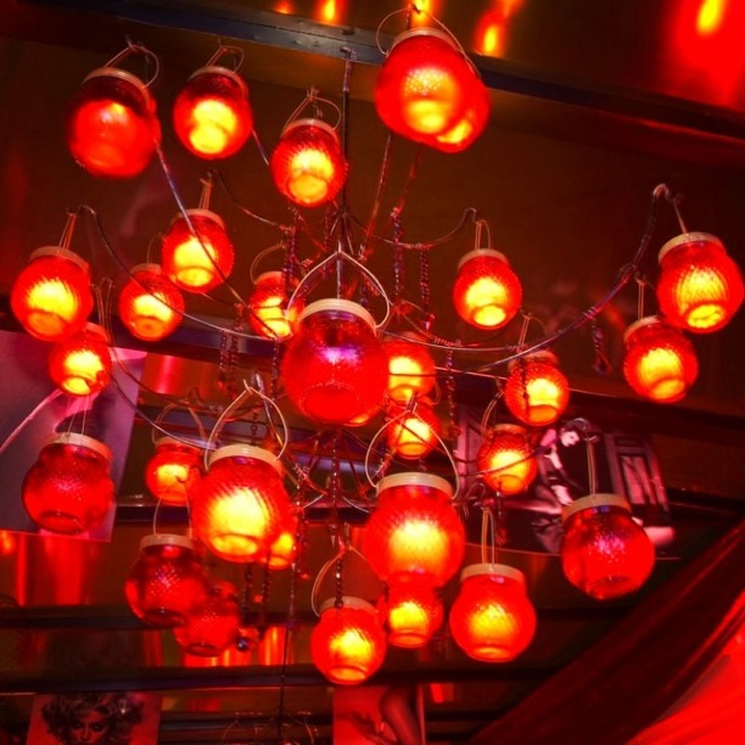 illuminated, lighting equipment, indoors, hanging, red, lantern, decoration, low angle view, electricity, in a row, night, electric light, chinese lantern, large group of objects, no people, light bulb, electric lamp, close-up, light - natural phenomenon, still life