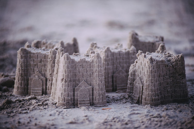 Close-Up Of Sand Castles At Beach