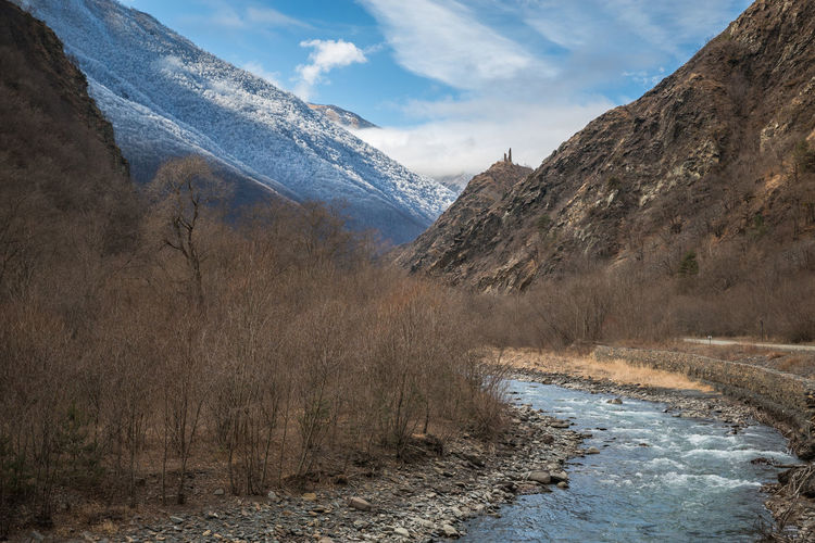 Scenic view of mountains against sky. mountain river