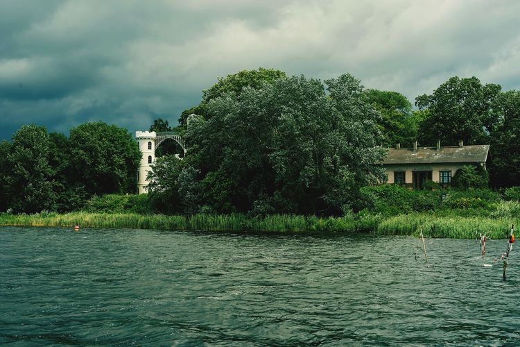 Water Built Structure Waterfront Architecture Tree Rippled Tranquility Tranquil Scene Cloud - Sky Building Exterior Sky Cloud Scenics Nature Cloudy Calm Day Outdoors Beauty In Nature Green Color Pfaueninsel Schloss Pfaueninsel Berlin