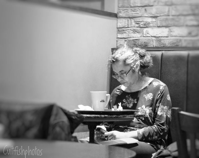 A conversation alone Streetphotography People Watching Real People One Person Indoors  Young Adult Old-fashioned One Woman Only Adult Only Women