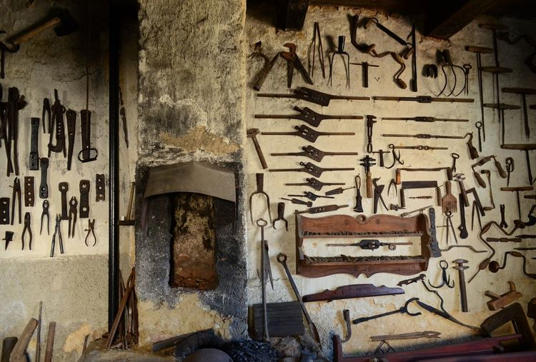 Abandoned Art And Craft Blacksmith  Blacksmithing Equipment Indoors  Large Group Of Objects Metal Metal Art Metalwork Obsolescence Obsolete Obsolete Old Out Of Date Run-down Rural Wall