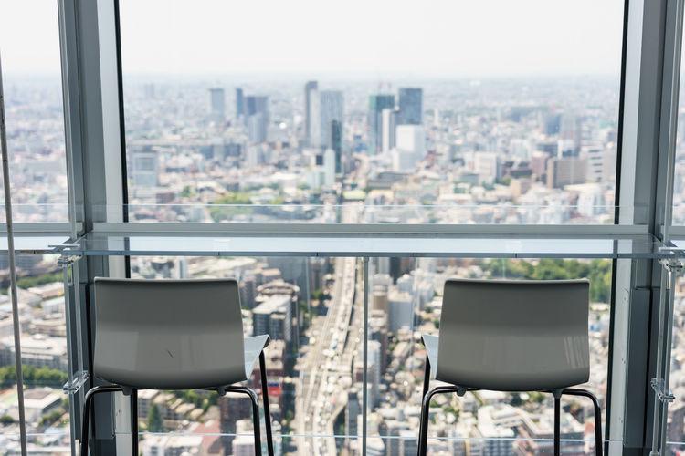 Cityscape seen through glass window