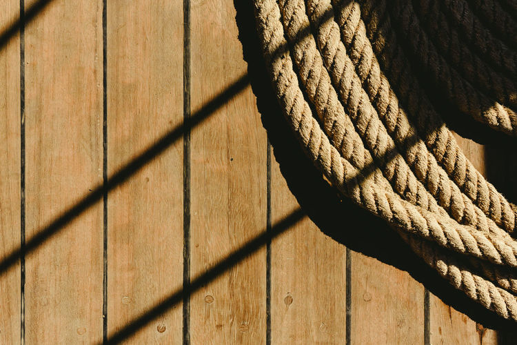 Shadow of rope on wood