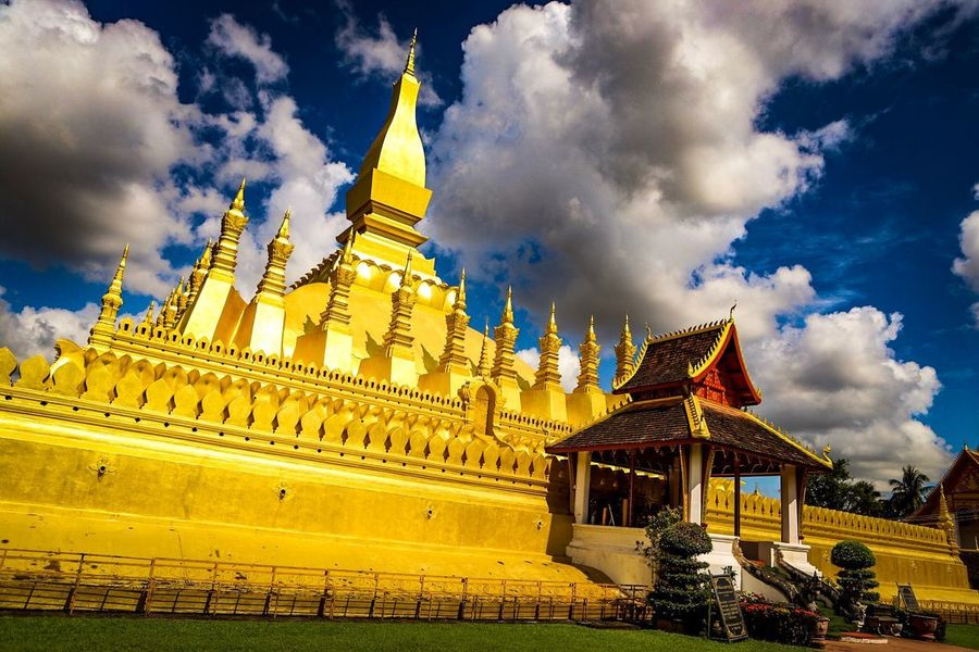 Buddhism Pha That Luang Cloud - Sky Architecture Built Structure Sky Building Exterior Building Religion Travel Destinations Place Of Worship Spirituality