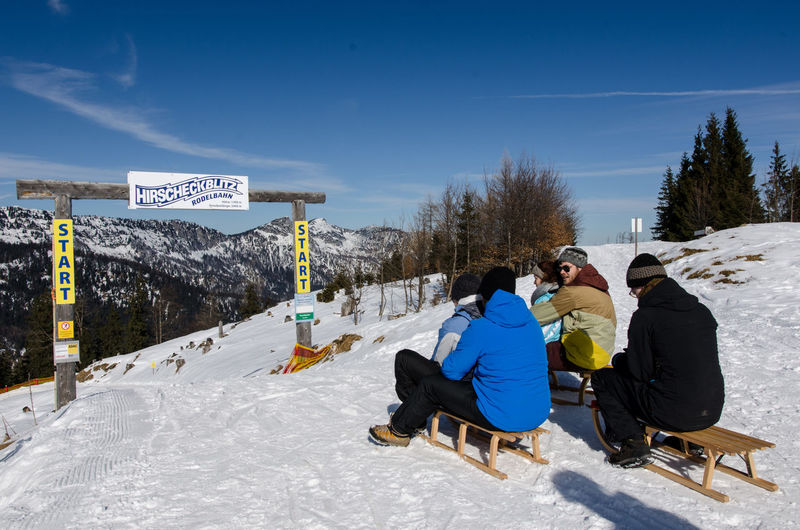 Beauty In Nature Cold Temperature Day Full Length Hirscheck Hirscheckblitz Leisure Activity Lifestyles Men Mountain Nature Outdoors Ramsau  Real People Rodeln Schlittenfahren Ski Holiday Sky Snow Sunlight Togetherness Vacations Warm Clothing Winter Winter