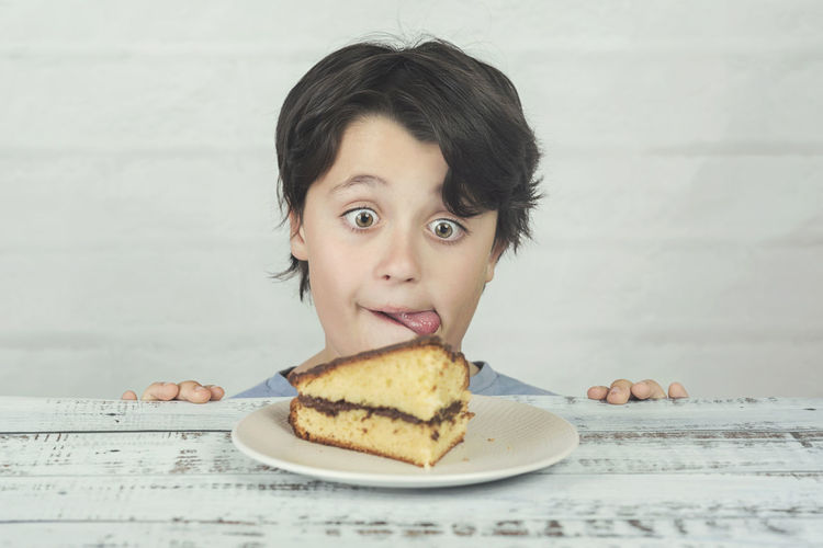 Portrait Food Food And Drink Childhood Child Table Breakfast Temptation Cake Hunger Hungry Expression Gluttony Glutton Snack Sponge Cake Chocolate Fattening Obesity Sweet Sweet Food Tasty Bakery Addiction Eating Diet Nutrition Piece Funny Delicious Homemade Homemade Food Homemade Bread Homemade Cake Happy Enjoy Lunch Unhealthy Eating