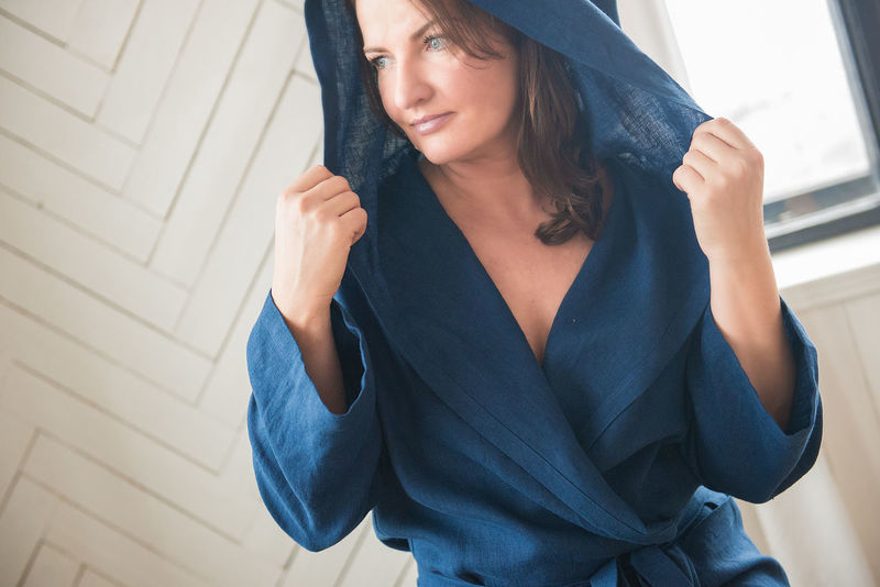 Fashion Fashion Stories Home Morning Natural Light Beautiful Woman Bedroom Blue Close-up Day Dressing Gown Front View Human Hand Indoors  Lifestyles Linen Model One Person Portrait Real People Robe Standing White Background Young Adult Young Women