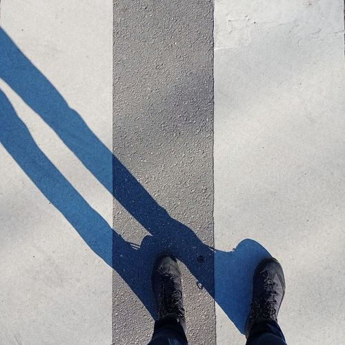 Low section of person standing on street