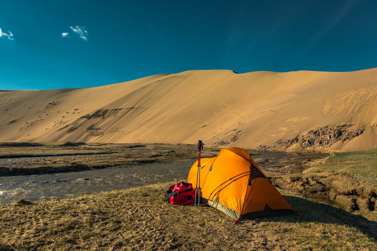 Mongolia Scenics - Nature Landscape Sky Environment Tent Land Remote Adventure Beauty In Nature Nature Sand Tranquil Scene Camping Tranquility Climate Desert Arid Climate Non-urban Scene Sunlight Sand Dune Outdoors The Traveler - 2019 EyeEm Awards