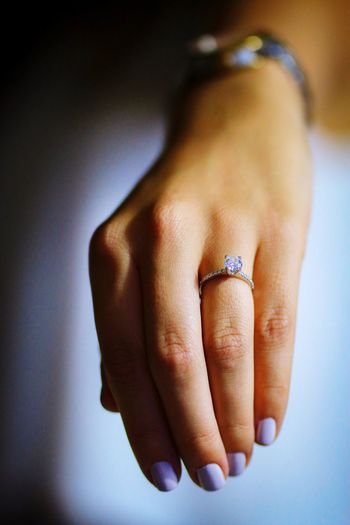 Close-up of woman showing wedding ring