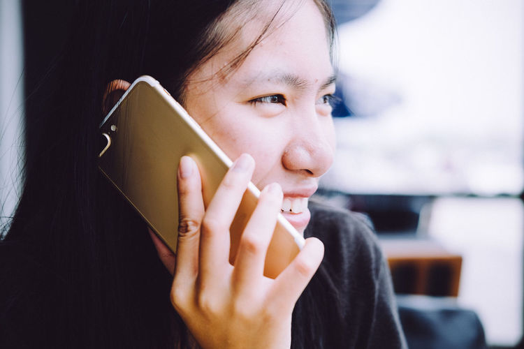Young cute hipster woman using smartphone in the cafe Adult Adults Only Beauty Calling Close-up Day Holding Human Body Part Human Hand Indoors  One Person One Woman Only One Young Woman Only Only Women People Real People Smart Phone Women Young Adult Young Women