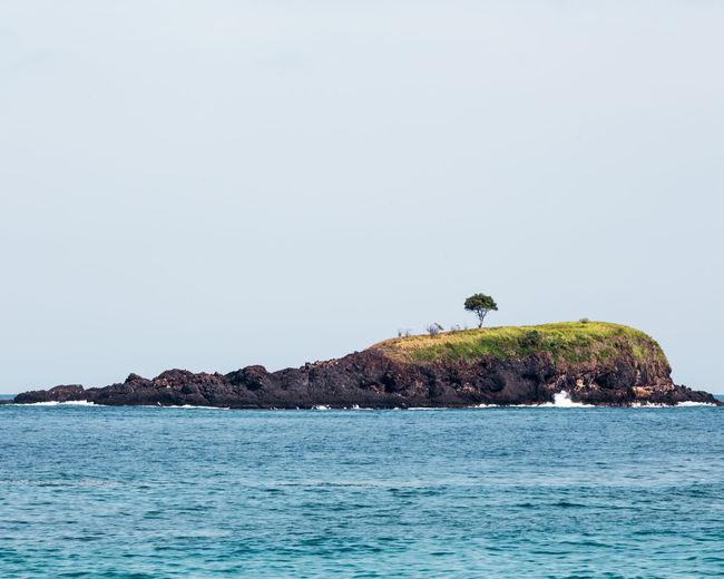 Island Against Clear Sky