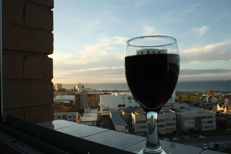 Glass half full indeed. Afternoon Architecture Bricks Building Exterior Built Structure City Cityscape Cloud Cloud - Sky Drink Food And Drink Freshness Glass Glass Half Full Port Elizabeth Port Elizabeth Sunset Sky Skyline Sunset View View From The Window... Wine