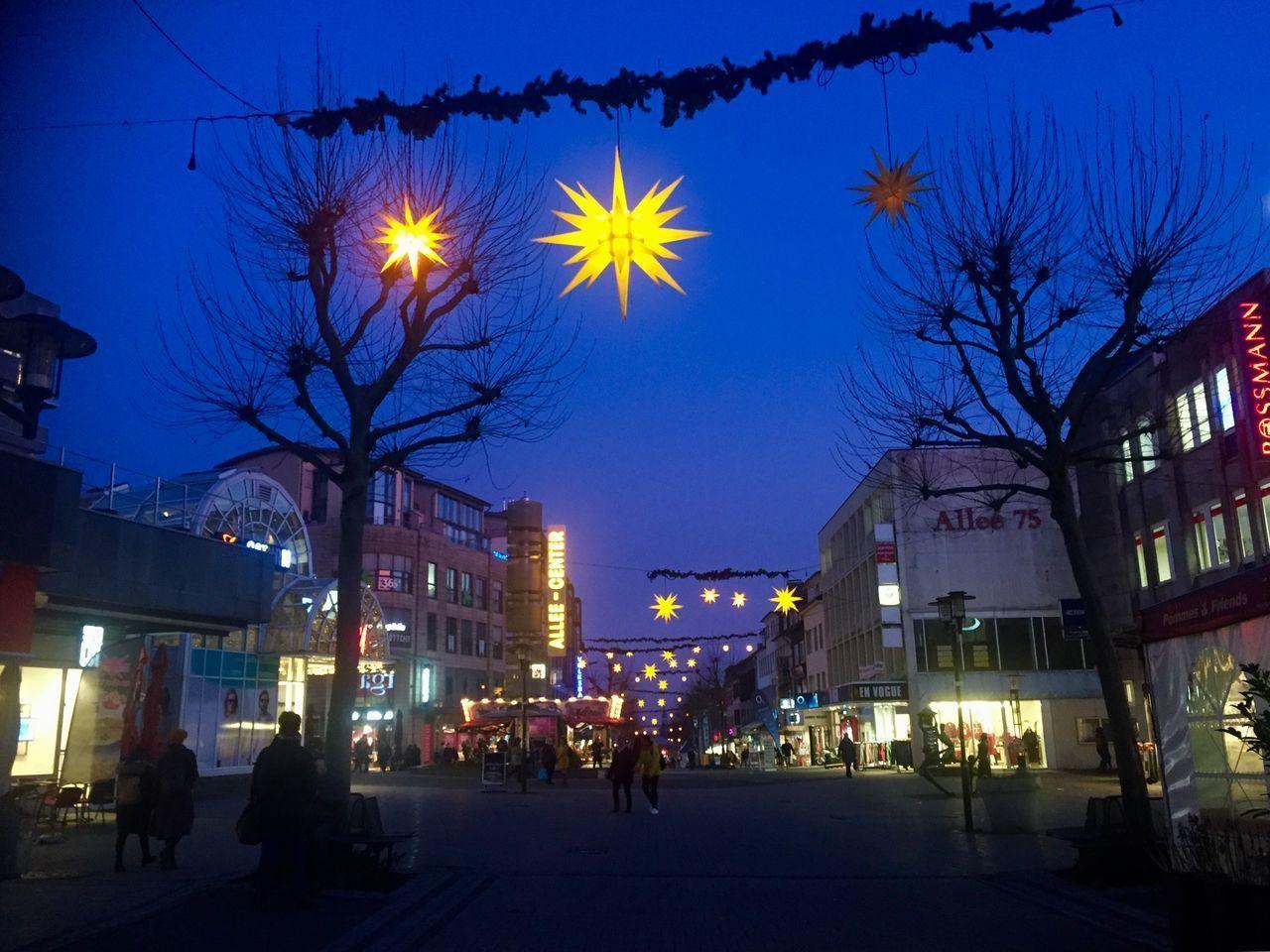 ILLUMINATED STREET LIGHTS AND BUILDINGS AT NIGHT