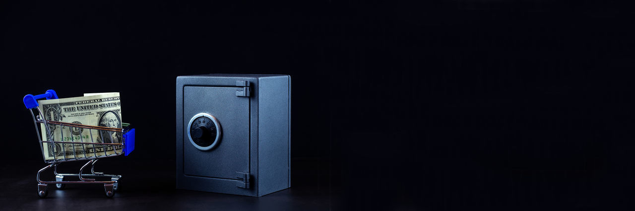 Close-up of telephone booth on table against black background