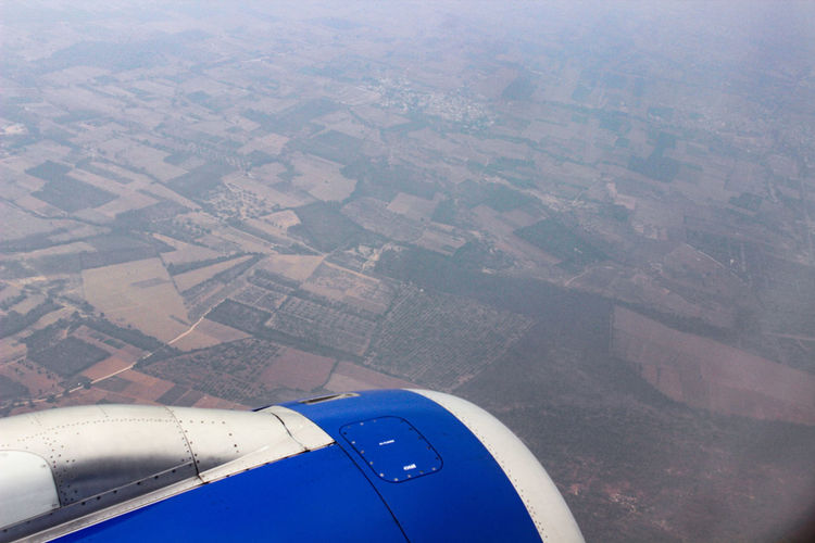 Aerial view of airplane flying over land
